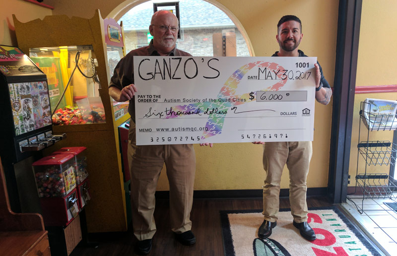 Donation presentation by the owner of Ganzo's Mexican Restaurant